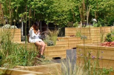 Planters and Seating at Coventry University | Timber Planters | Broxap Street Furniture